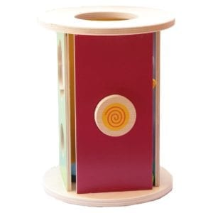image of round shape sorter from the angle that shows a red side with a round button that baby can grab hold of
