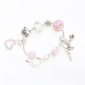 gift jewellery silver charm bracelet with pink princess theme has silver fairy charm and bell and various diamanté, silver, and pink coloured charms - product image