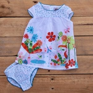 baby girls dress with tropical print and white nappy cover pants with blue polka dots - product image front