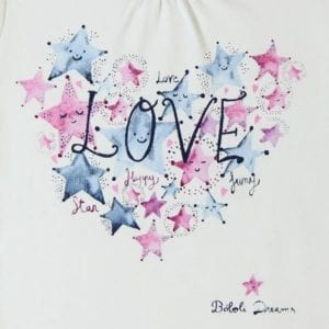 detail view of pyjama top features star and love graphic on the front.