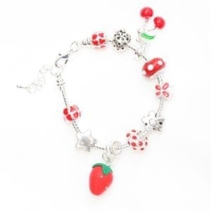 gift jewellery silver charm bracelet with red fruit theme has red enamelled strawberry and various diamanté, silver, and red coloured charms - product image