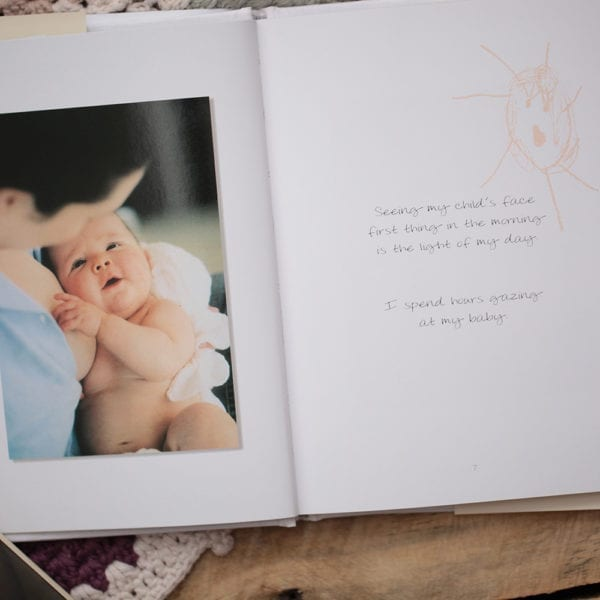 gift book image shows photo of mum nursing baby and phrase of text