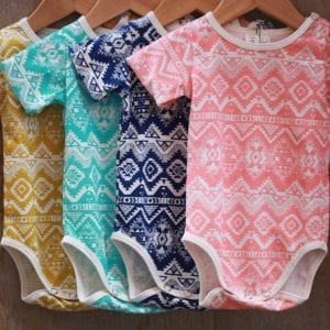 Baby Aztec Print rompers image of four different colour prints on hangers