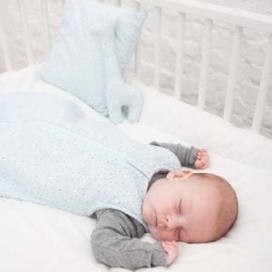 sleeping bag freckles lifestyle image of baby sleeping in cot