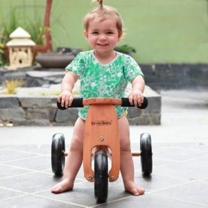 baby girl on kinderfeet trike product image