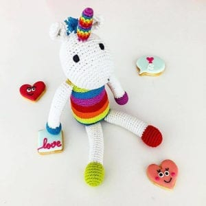 unicorn soft toy hand made organic cotton crochet white with bright coloured stripes - product image